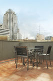 Urban terrace with furniture and building. Royalty Free Stock Image