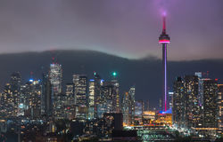 Urban Toronto illuminated skyline - glowing rain cloud quickly moves in to the downtown core. Royalty Free Stock Images