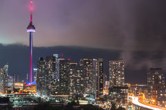 Urban Toronto illuminated skyline - glowing rain cloud quickly moves in to the downtown core. Royalty Free Stock Photography