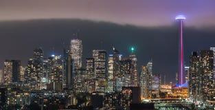 Urban Toronto illuminated skyline - Illuminated rain cloud quickly moves in. Royalty Free Stock Images