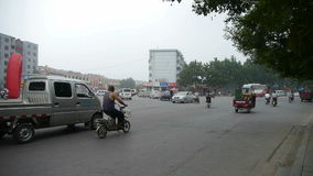 Urban town busy road traffic,China Chinese people. stock video footage