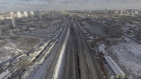 Urban town view. Aerial view industrial city landscape. road with driving cars. small river in winser season. kyiv ukraine cityscape with snow sunny day stock footage