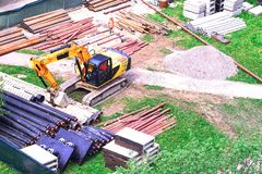 Urban tractor equipment for digging. The pipes are ready for laying in the ground. The excavator is ready to dig a trench. Working stock photos