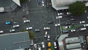 Urban traffic from above. Urban road intersection with passing cars stock footage
