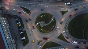 Urban traffic above roundabout. Night view from above over city circle traffic. Urban roundabout is working like a big machine part stock footage