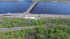 Urban traffic along the Dnieper River in Kiev. Aerial cityscape in sunny weather stock footage