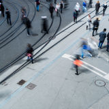 Urban traffic concept - city street with a motion blurred crowd Stock Photos