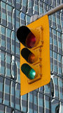 Urban traffic light. Overhead traffic light on green with glass windows of urban high rise building in background Stock Photography
