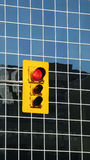 Urban traffic light on red stock photography