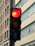 Urban traffic light on red Royalty Free Stock Image
