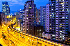 Urban traffic at night with modern buildings Royalty Free Stock Photos