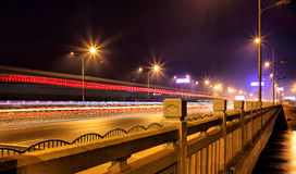 Urban traffic after nightfall A long exposure photo on a highway in china. Long exposure photograph of the city traffic at night.On the bridge. Colorful Royalty Free Stock Image