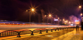 Urban traffic after nightfall A long exposure photo on a highway in china. Long exposure photograph of the city traffic at night. Colorful Royalty Free Stock Photos