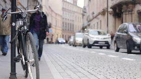 Urban traffic - pedestrians, cars and bicycle on historic street stock video footage