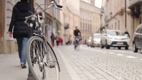 Urban traffic - pedestrians, cars and bicycle on historic street stock footage