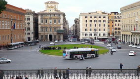 Urban traffic in Piazza Venezia in Rome stock footage