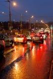 Urban traffic in rainy evening Stock Photos