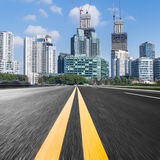 Urban traffic road with cityscape in background in Shanghai. China Royalty Free Stock Photos