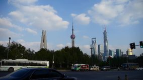 Urban traffic with Shanghai lujiazui business building background. stock footage