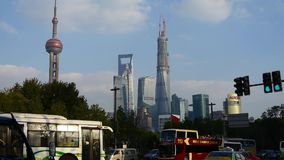 Urban traffic with Shanghai lujiazui business building background. stock video
