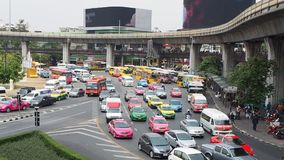 Urban traffic at Victory Monument, Bangkok. Urban traffic at Victory Monument in direction of Phayathai Road in Ratchathewi district of Thai capital Bangkok on stock footage