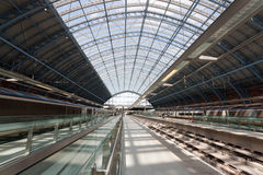 An urban train station with glass roof Royalty Free Stock Images