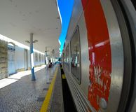 Urban train station - Lisbon. Composition of train stopped at the station of a touristic city near Lisbon, called `convoy` in Portugal, the rail transport of Royalty Free Stock Images