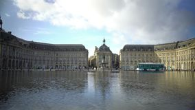 Urban transport crossing beautiful Place de la Bourse square in Bordeaux, France. Stock footage stock footage