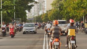 NHA TRANG, VIETNAM - OCTOBER 1, 2016: Urban transport in the daytime. The movement of motorcyclists. Infrastructure of stock video footage