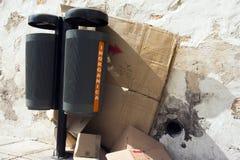 Urban trash bins and cardboard boxes Stock Photography