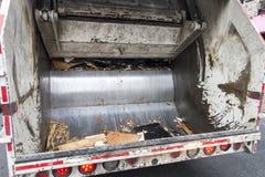 City garbage truck back crusher. Urban trash truck back hydrolic crusher royalty free stock photo