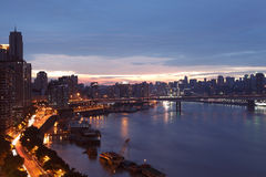 Urban twilight Chongqing. Chongqing, China - September 02, 2012: Urban scene, the Jialingjiang River and city buildings. twilight of the city stock images