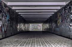 Urban underground tunnel with modern graffiti. Old underground tunnel with modern creative graffiti stock illustration