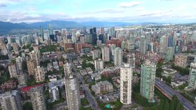 Urban Vancouver city financial district downtown in 4k aerial cityscape panorama with modern skyscrapers and towers stock video footage