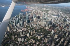 Urban Vancouver flight view cityscapes downtown. On the flight to discovery vancouver city downtown cityscapes stadium building global view of the city until royalty free stock images