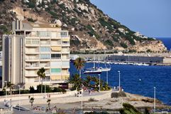 Urban View of Calpe. Mediterranean Resort Calpe, Spain with Penon de Ifach and Hotel Buildings Stock Photo