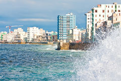 Urban view of Havana with a stormy sea Stock Photos