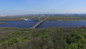 Urban view of the river and park in the megacity Kiev. Aerial cityscape in sunny weather stock video footage