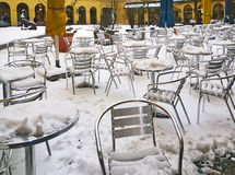 Urban view of snow in Munich, Germany - open air restaurant chai Royalty Free Stock Images