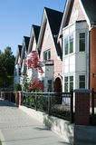 Urban view - townhouses or condominiums. A row of newly built townhouses or condominiums Royalty Free Stock Photography