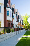 Urban view - townhouses or condominiums. A row of newly built townhouses or condominiums Stock Photos