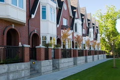 Urban view - townhouses or condominiums. A row of newly built townhouses or condominiums Royalty Free Stock Image