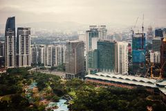 Urban views of Kuala Lumpur with tall skyscrapers, drowning in the greenery of parks. Malaysia royalty free stock image