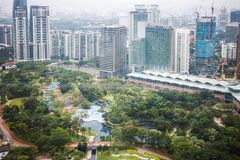Urban views of Kuala Lumpur with tall skyscrapers, drowning in the greenery of parks. Malaysia stock photo