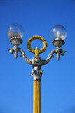 Urban vintage street lamp on a background of blue sky Stock Images