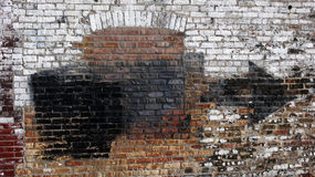 Urban Wall. Old weathered urban wall with bricked up window Royalty Free Stock Photo