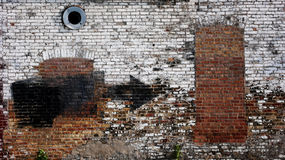 Urban Wall. Old weathered urban wall with bricked up window and door Stock Photography