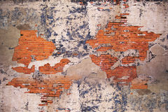 Urban Wall. Old weathered urban wall with bricks and cracked paint Stock Photography