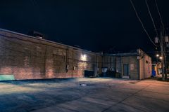 Urban warehouse building at night Stock Photo