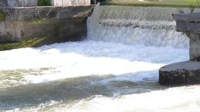 Urban water gateway. Splashes and droplets in the air. Waterfall. Real time stock footage